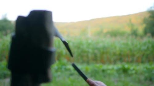 Farmer Are Sharpening Scythe Tool Stone