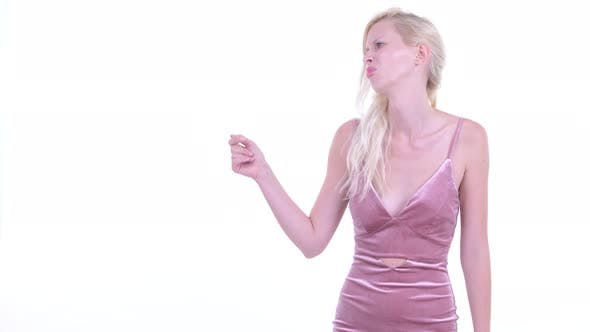 Thumbnail for Stressed Young Blonde Woman Snapping Fingers and Giving Thumbs Down