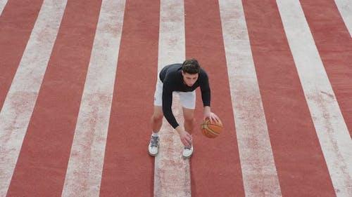 Dribbling a basketball ball