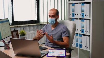 Man Using Laptop for Video Meeting