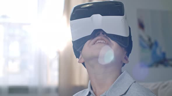 Thumbnail for Cute Little Boy Experiencing Virtual Reality