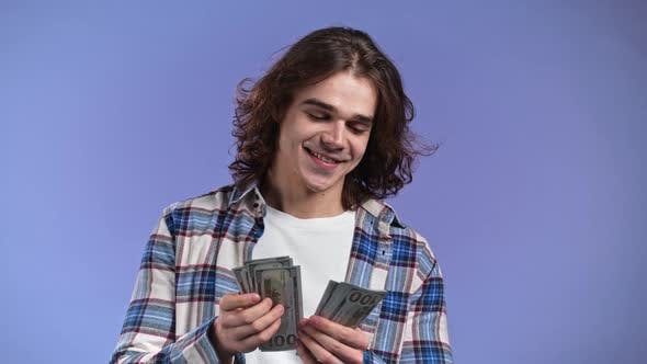 Satisfied Man Counting USD Currency
