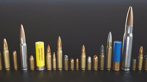 An endless row of different ammunition types standing on the ground in a loop.