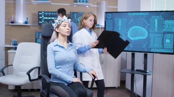 Cover Image for Female Patient with Eyes Closed Wearing Brainwaves Scaning Headset