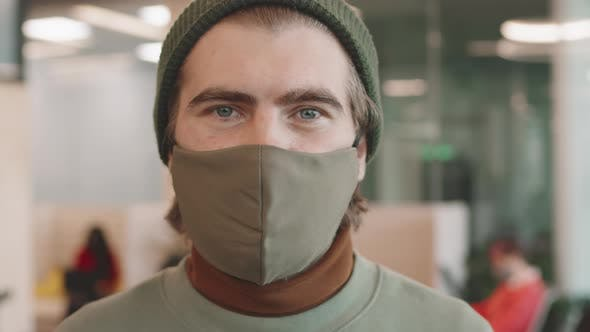 Man in Beanie Hat and Face Mask Posing