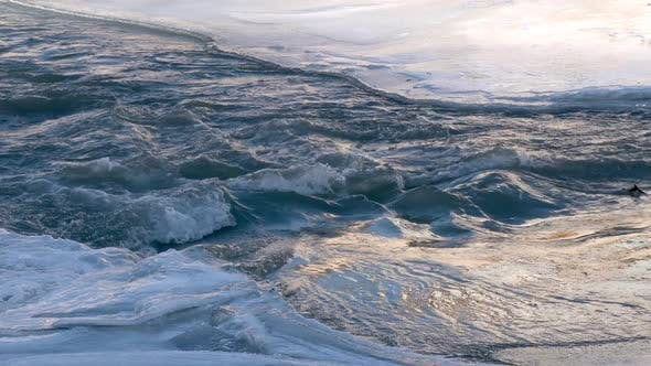 River Flowing Under Frozen Ice Sheets