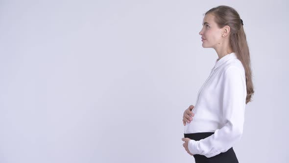 Thumbnail for Profile View of Young Happy Pregnant Businesswoman Looking Up