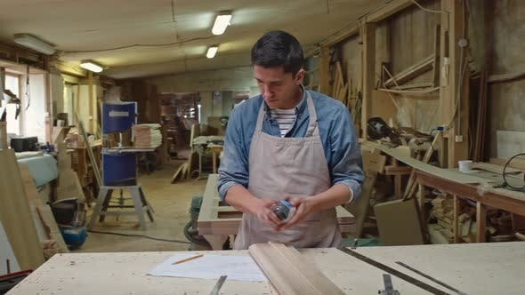 Thumbnail for Woodworker Checking Size of Board