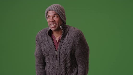 Thumbnail for An African American man stands trembling on green screen