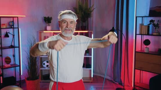 Old Bearded Man in Sportswear Doing Strength Exercises Using Resistance Rubber Band