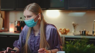 Young Business Woman in Protective Mask Working at Home on Quarantine