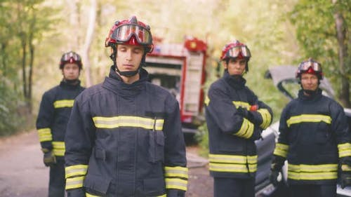 Confident Firefighters on Accident Site