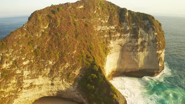Thumbnail for Huge Waves Hit a Sandy Beach and Rocks in Kelingking Beach, Nusa Penida, Bali, Indonesia. Aerial