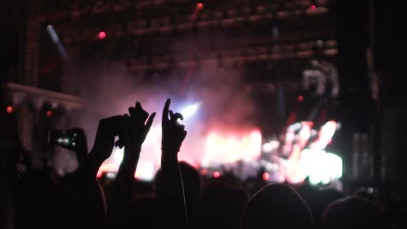 Thumbnail for Great Light Show on Stage, Crowd Waving Hands in Darkness, People at Concert