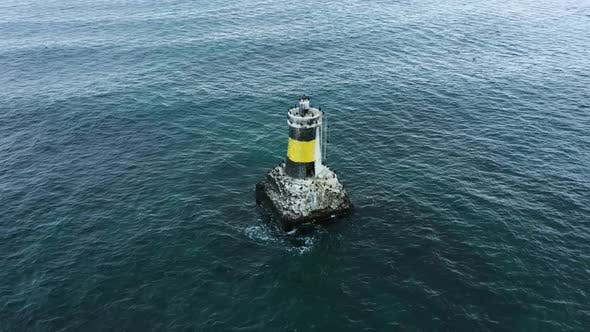 Aerial view of lighthouse in the sea