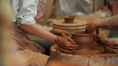 Pottery Classes Woman Making Clay Pot on Wheel