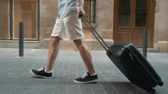 Thumbnail for Close Up on Lower or Bottom Part of Business Man Leg Walking Forward with Blue Baggage on the