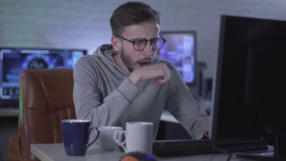 Thumbnail for Portrait of Exhausted Programmer or IT Developer Yawning, Taking Off Eyeglasses and Rubbing Eyes