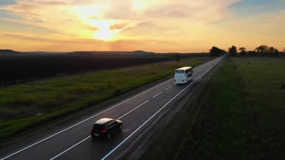 Aerial Drone View White Tourist Bus Driving Away for a Journey