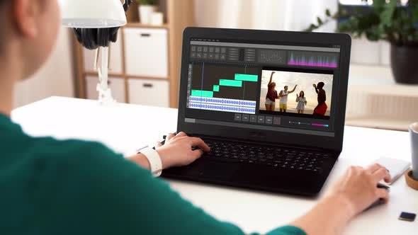 Cover Image for Woman with Video Editor Program on Laptop at Home