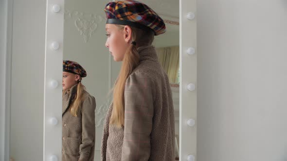 Thumbnail for Elegant Teen Girl Looking at Mirror and Window