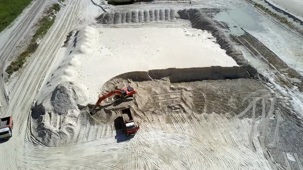 Thumbnail for Lorry Drives To Sand Pit with White Ore and Digger Aerial
