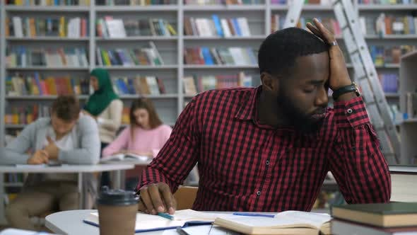 Tired Black Student Studying Difficult Assignment