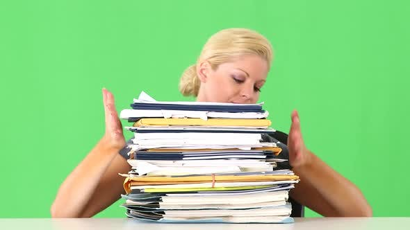 Thumbnail for Portrait of businesswoman overwhelmed with large pile of work