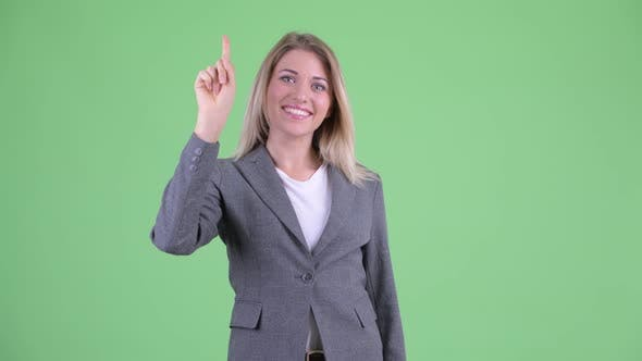 Thumbnail for Happy Young Beautiful Blonde Businesswoman Pointing Up