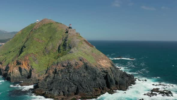 Thumbnail for Incredible Nautical Nature with Lighthouse on High Rocky Inaccessible Island,