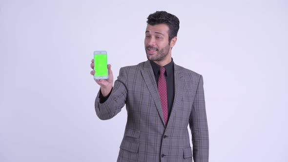 Thumbnail for Happy Bearded Persian Businessman Showing Phone