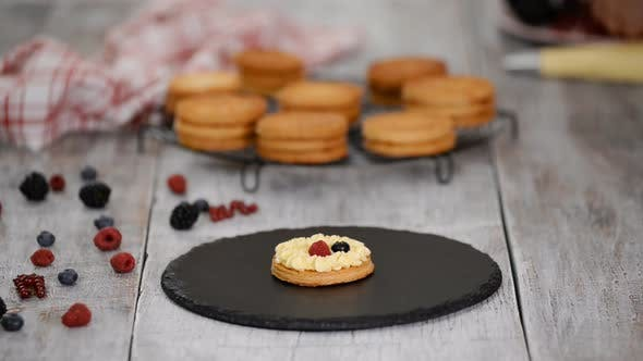 Cover Image for Pastry chef making French Mille Feuille with custard and berries