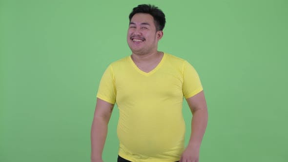 Thumbnail for Happy Young Overweight Asian Man Waving Hand