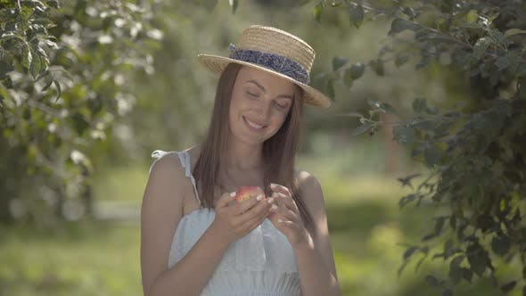 Thumbnail for Adorable Fashion Young Positive Woman in Straw Hat and White Dress Looking at the Camera Smiling