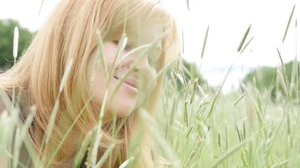 Thumbnail for Caucasian blonde woman playing in the  nature  with grass 1080p slow motion HD footage - Beautiful b
