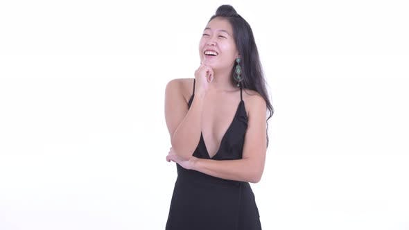 Thumbnail for Happy Beautiful Asian Woman Thinking Ready To Party