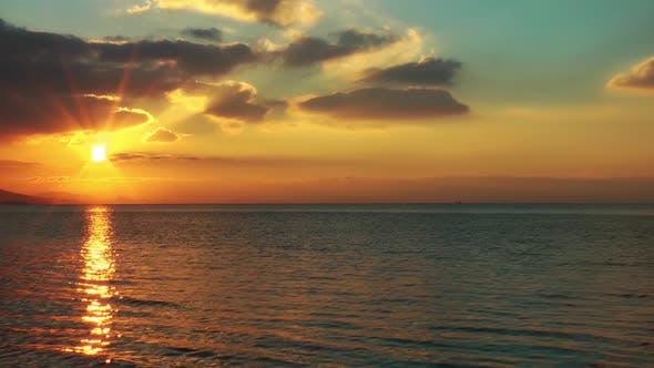 Cloudy Yellow Sea Sunset