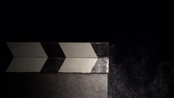 Thumbnail for Clapboard with a Cloud of Chalk Dust. Close Up. Black Background