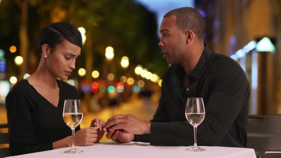Thumbnail for Loving African couple get engaged while out on a nice dinner date