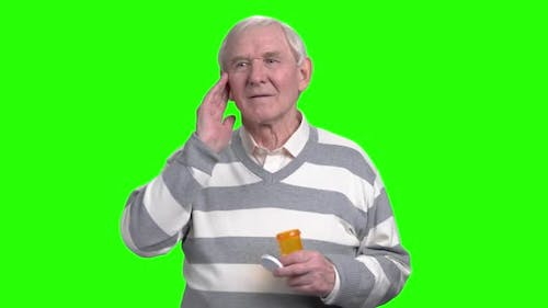 Old Man with Headache Holding Painkillers