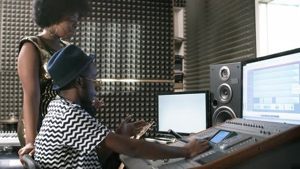 Thumbnail for Woman and Sound Engineer Working in Recording Studio