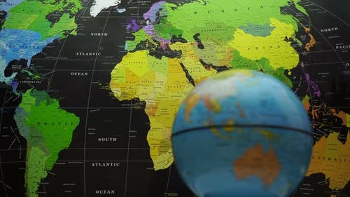 Rotating Globe On World Map Background.