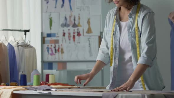 Cover Image for Fashion Designer Working Patterns in Her Studio, Clothing Industry, Business