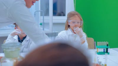 Teacher and Children in Chemistry Class