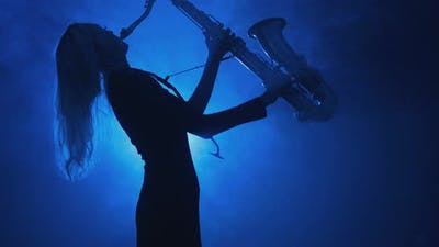 Silhouette of Girl Playing Saxophone