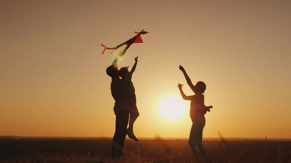 Thumbnail for Summer Activity - the Family Plays Carefree with a Kite