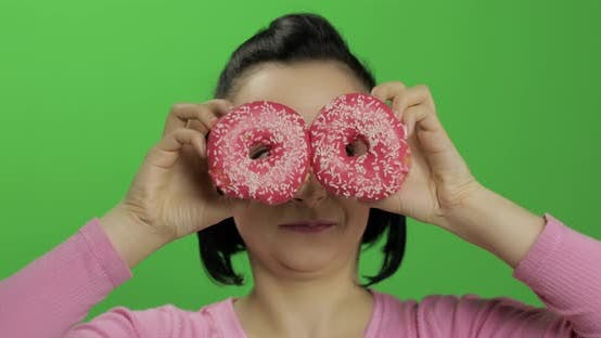 Happy Beautiful Young Girl Posing and Having Fun with Donuts. Chroma Key