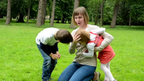 Thumbnail for Middle Aged Mother Plays with Children, Boy and Girl in the Park