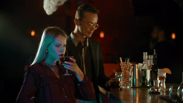 Thumbnail for A Man Meeting a Girl in the Bar - Standing By the Stand and Start Talking