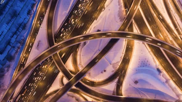 Illuminated Road Junction and Cars Traffic at Winter Evening. Flyover. Aerial View